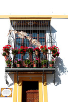 Typical geranium covered balcony in Seville